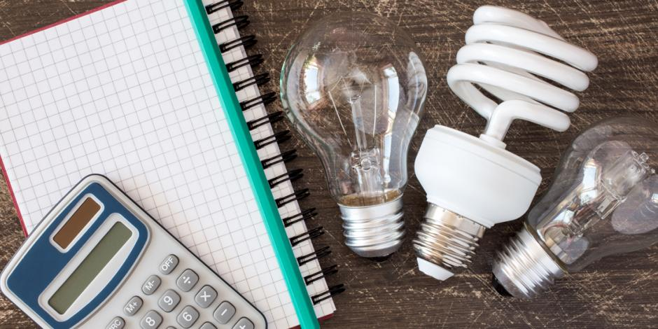 light bulbs notepad calculator on desk